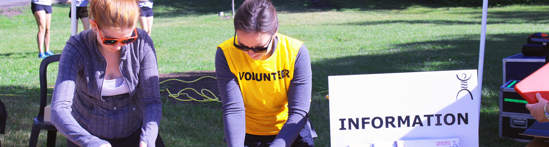 Volunteers working at a desk at Gutsywalk